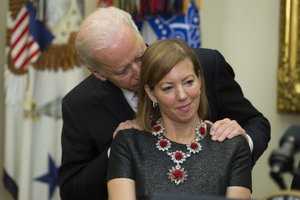 Biden with Carter's wife (Evan Vucci for AP)
